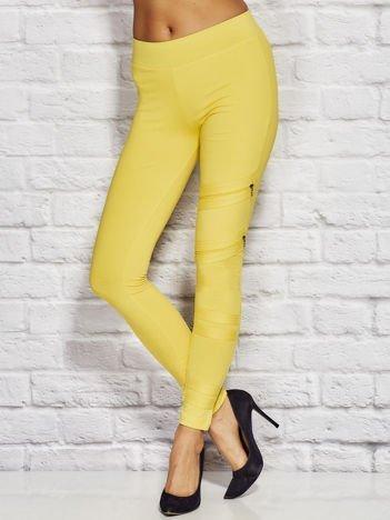 Żółte legginsy z suwakami