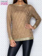 Ażurowy sweter beżowy ze złotym wykończeniem