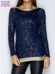 Ażurowy sweter granatowy ze złotym wykończeniem
