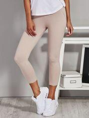 Beżowe legginsy damskie z przeszyciami