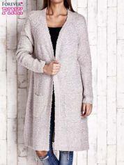 Beżowy wełniany sweter bouclé z kieszeniami