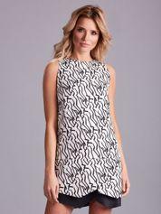 Biała asymetryczna sukienka we wzory