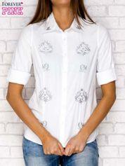 Biała koszula z ornamentowym haftem