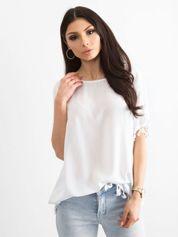 Bluzka damska z pomponikami biała