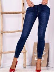 Ciemnoniebieskie jeansy high waist z suwakami