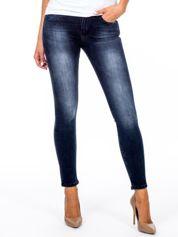 Ciemnoniebieskie jeansy z suwakami na nogawkach