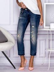 Ciemnoniebieskie spodnie jeansowe z przedarciami
