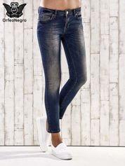 Ciemnoniebieskie spodnie skinny jeans z ćwiekami