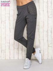 Ciemnoszare spodnie dresowe z napami