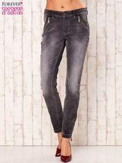 Ciemnoszare spodnie jeansowe z suwakami
