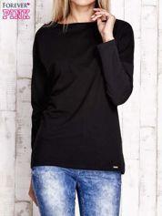 Czarna bluzka z wycięciem na plecach i kokardą