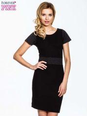Czarna sukienka z aplikacją w pasie i na rękawach