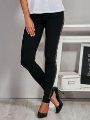 Czarne legginsy z błyszczącą aplikacją