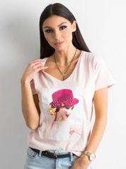 Damski jasnoróżowy t-shirt z aplikacją