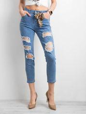 Damskie spodnie jeansowe z dziurami niebieskie
