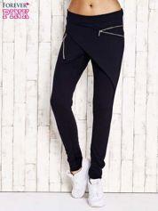 Granatowe spodnie dresowe z suwakami