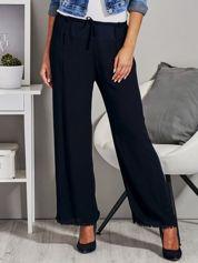 Granatowe szerokie spodnie z wiązaniem