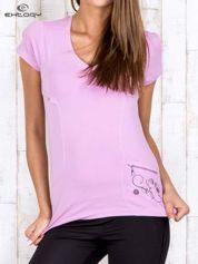 Jasnofioletowy gładki t-shirt modelujący w sportowym stylu