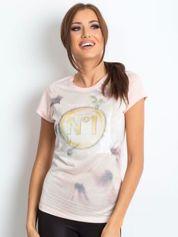 Jasnoróżowy t-shirt z graficznym nadrukiem