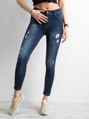 Jeansowe spodnie skinny z przetarciami niebieskie