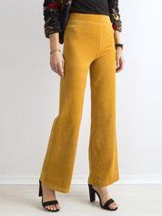 Musztardowe szerokie spodnie sztruksowe