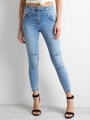 Niebieskie jeansy high waist z suwakami