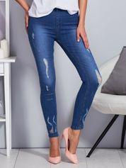 Niebieskie jeansy z koronkowymi wstawkami