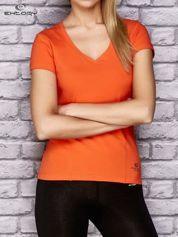 Pomarańczowy damski t-shirt sportowy z modelującymi przeszyciami