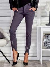 Spodnie damskie z suwakami ciemnoszare