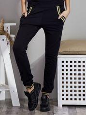 Spodnie dresowe czarne z błyszczącymi lampasami