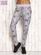 Spodnie dresowe z brokatową aplikacją i nadrukiem szare