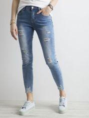 Spodnie jeansowe skinny z przetarciami niebieskie