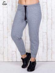 Szare melanżowe spodnie dresowe PLUS SIZE