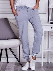 Szare spodnie dresowe z lampasami i troczkami