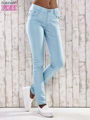 Turkusowe spodnie skinny jeans z dżetami
