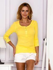 Żółta bluzka w drobny ażurowy wzór z guzikami