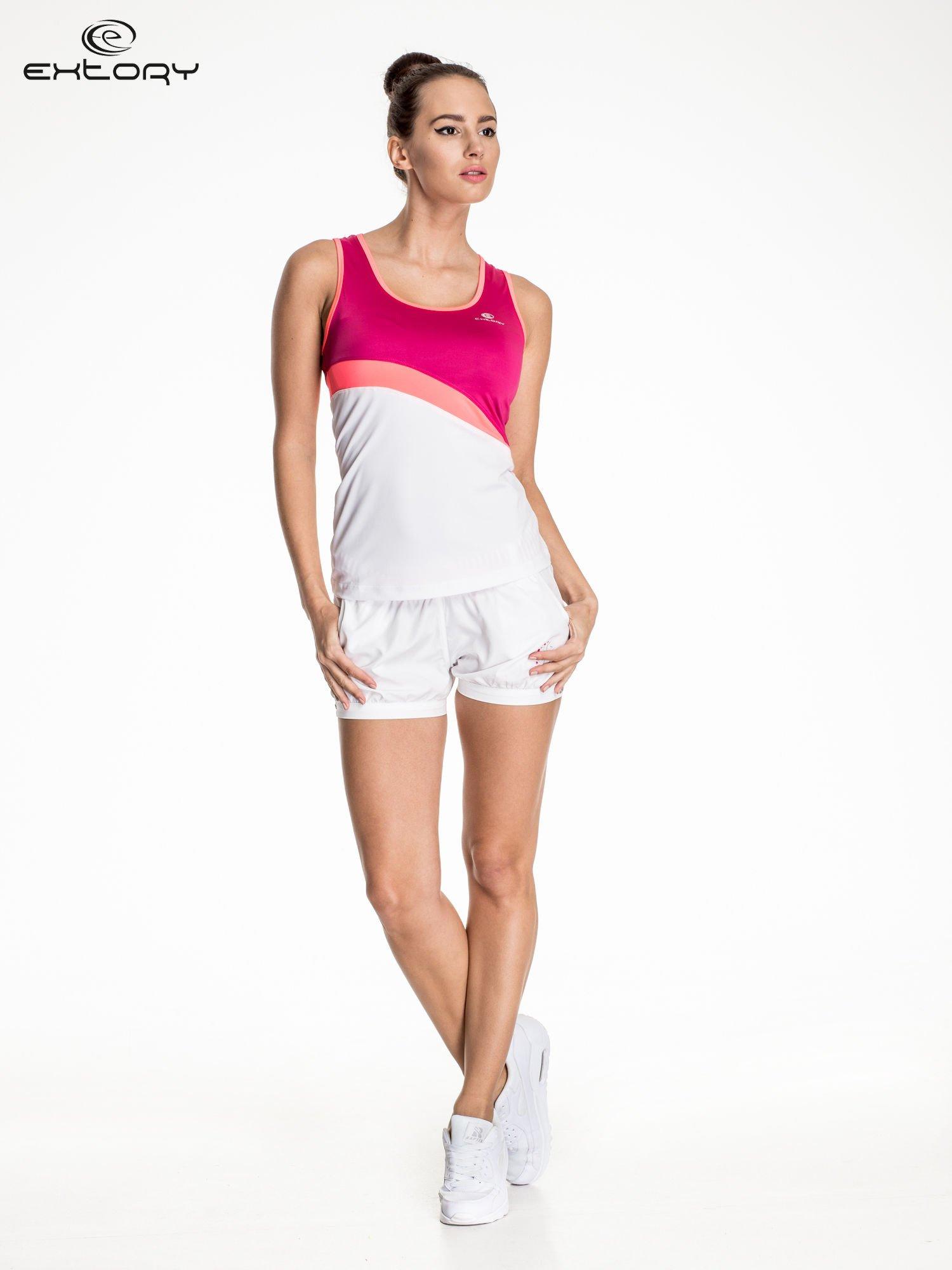 Biały damski top sportowy z różowym modułem                                  zdj.                                  2