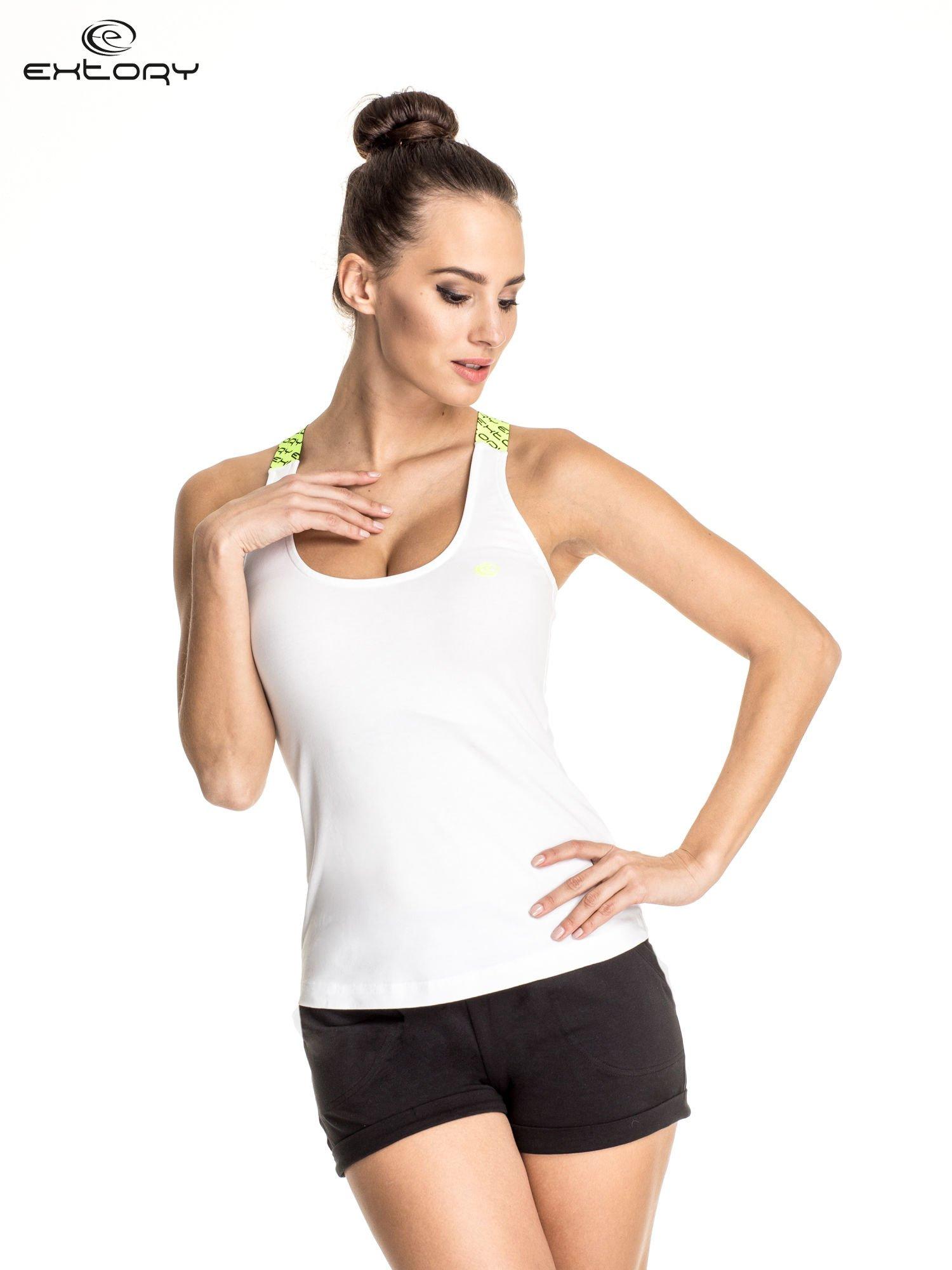 Biały top sportowy z żółtymi ramiączkami na krzyż                                  zdj.                                  1