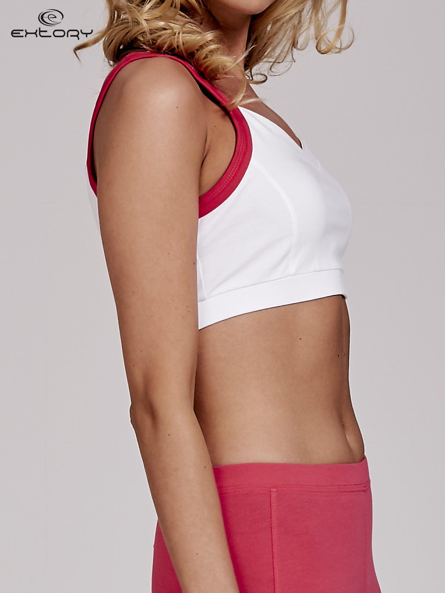 Biały top stanik sportowy z różowymi ramiączkami i wycięciem z tyłu                                  zdj.                                  3