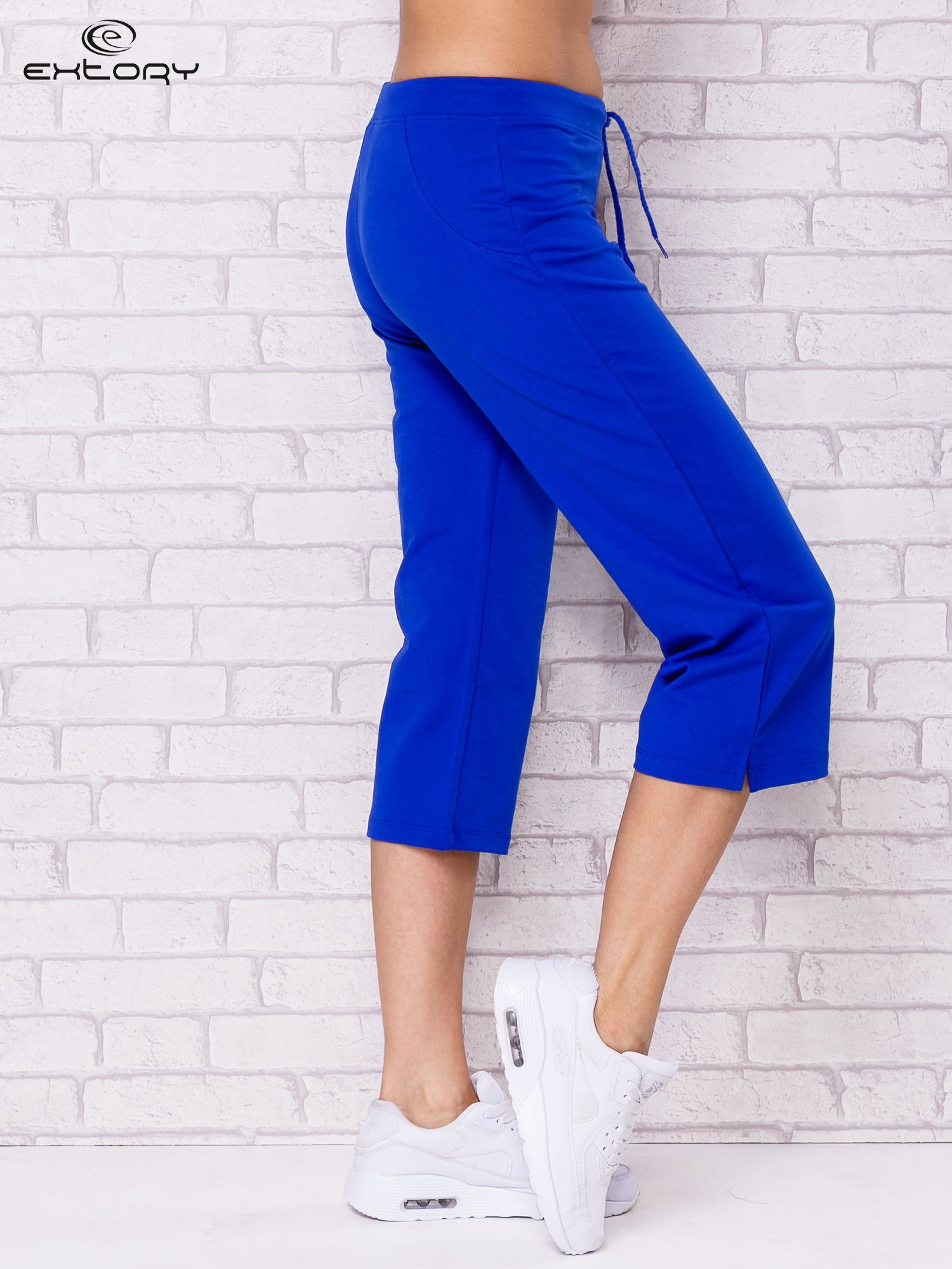 Ciemnoniebieskie spodnie sportowe capri                                  zdj.                                  2
