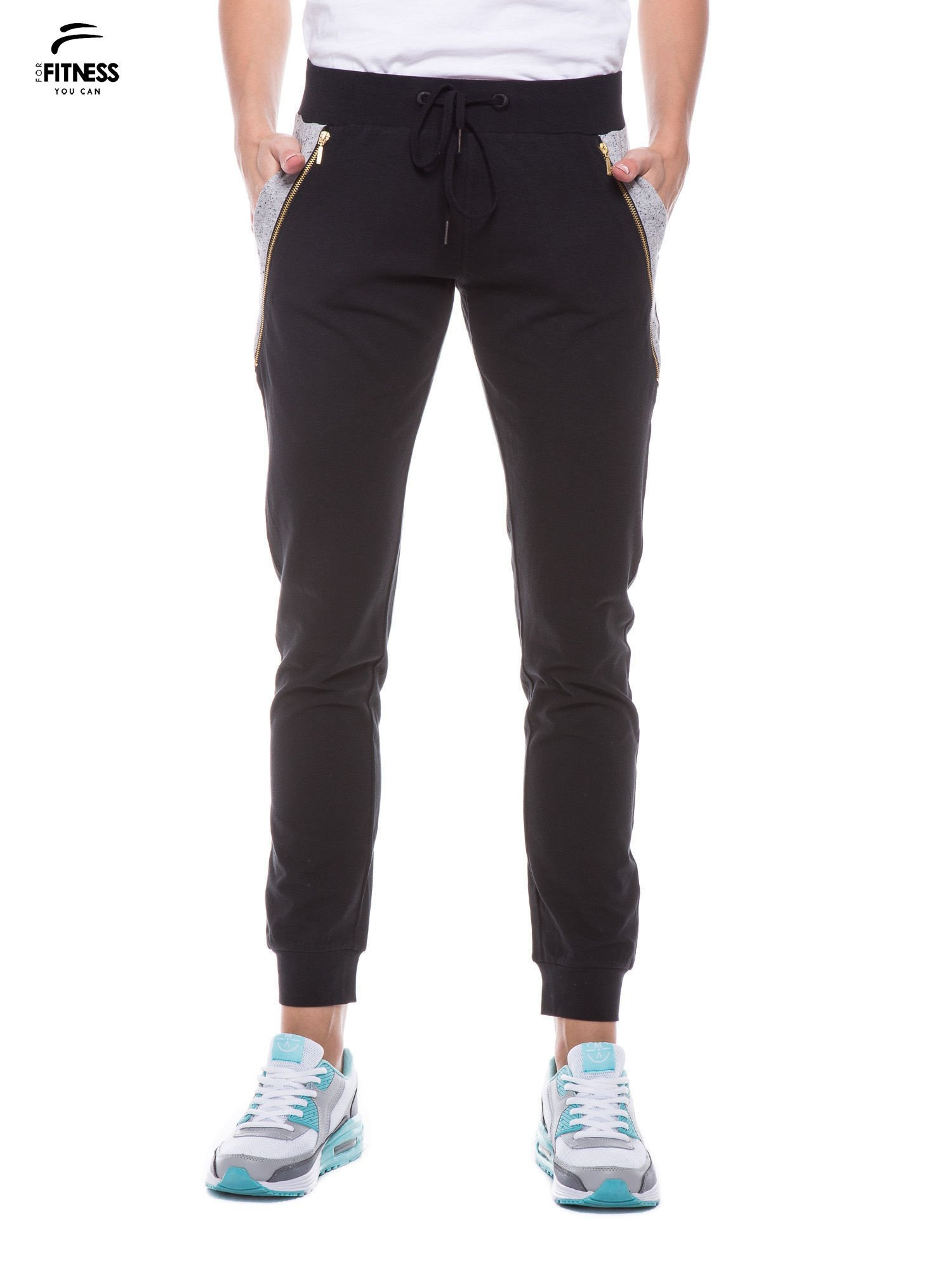 Czarne spodnie dresowe damskie z suwakiem i kontrastowymi wstawkami po bokach                                  zdj.                                  1