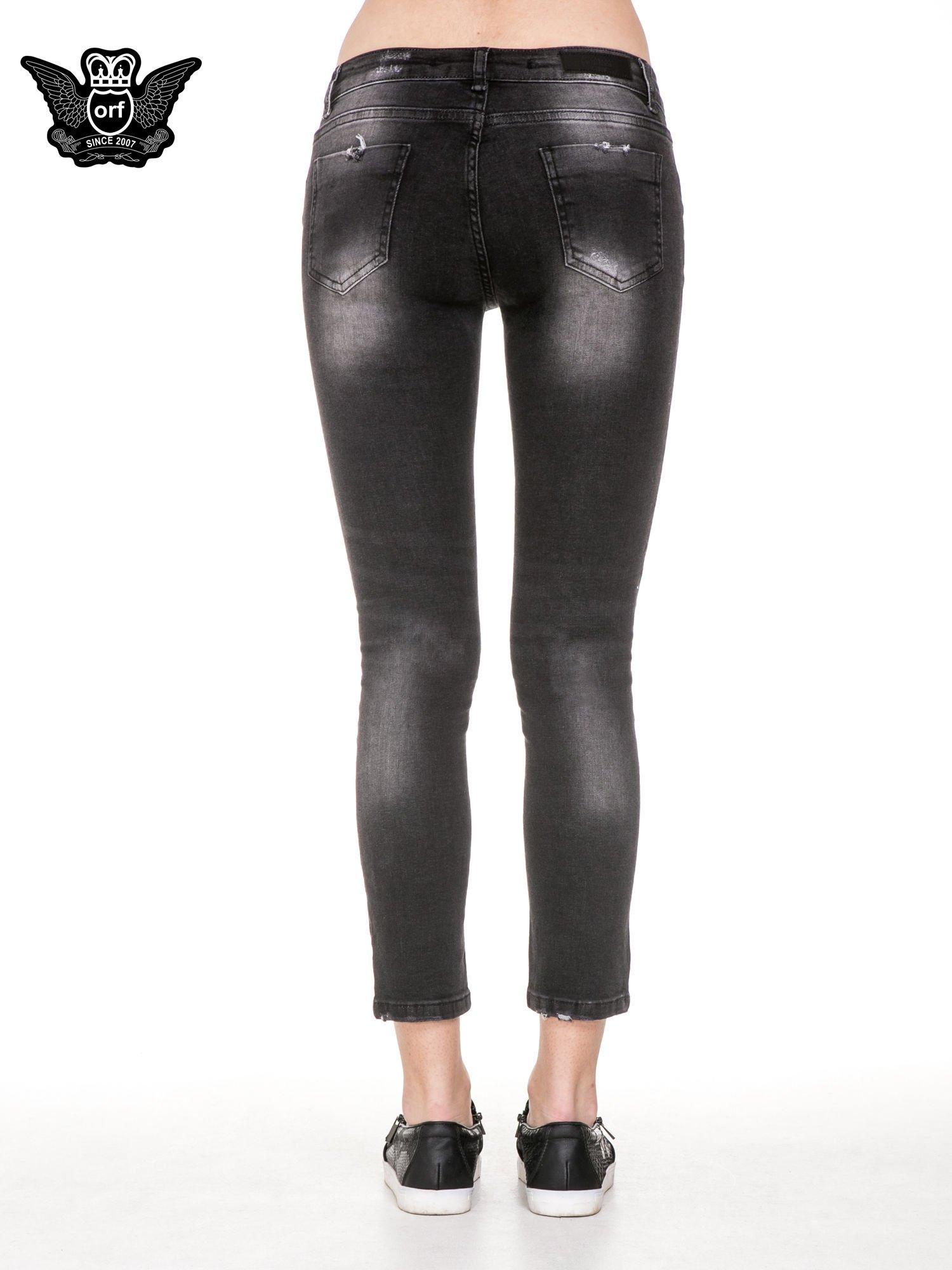 Czarne spodnie jeansowe 7/8 z rozjaśnianą nogawką                                  zdj.                                  6
