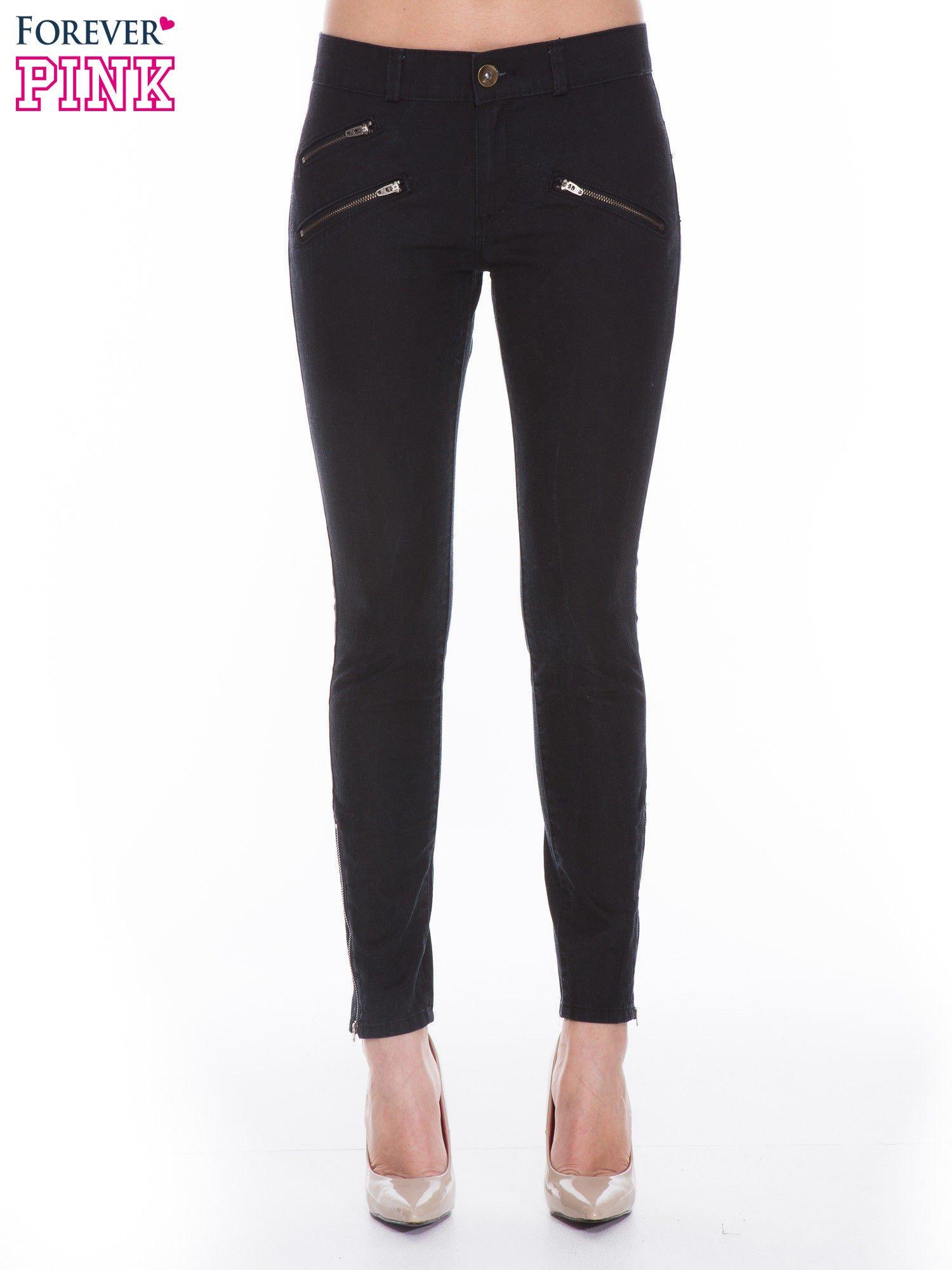 Czarne spodnie jeansowe typu skinny z suwakami na górze i przy nogawkach                                  zdj.                                  1
