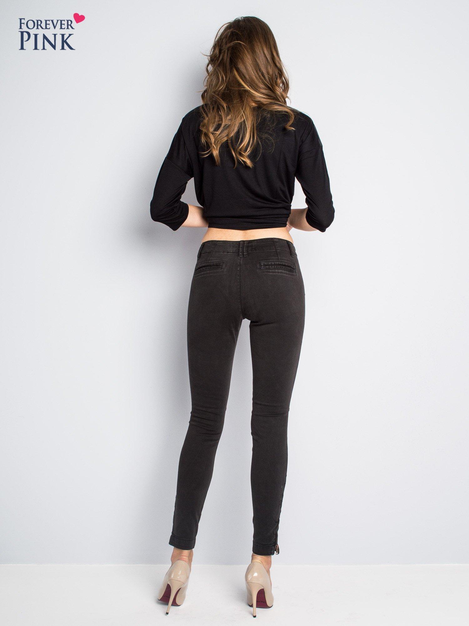 Czarne spodnie typu rurki z suwakami wzdłuż nogawek i z przodu                                  zdj.                                  8