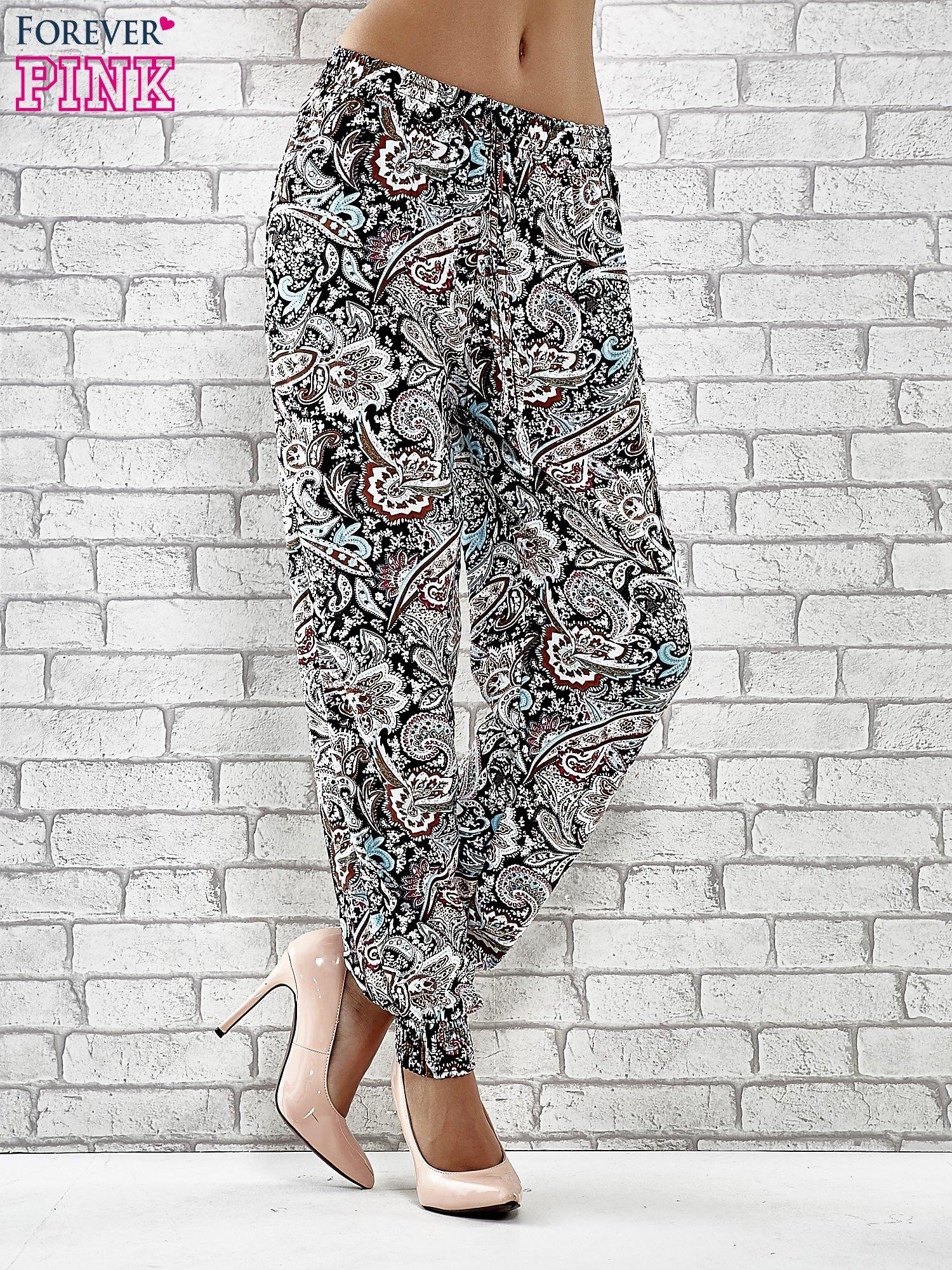 646ef32c Czarne zwiewne spodnie alladynki we wzór kwiatowy