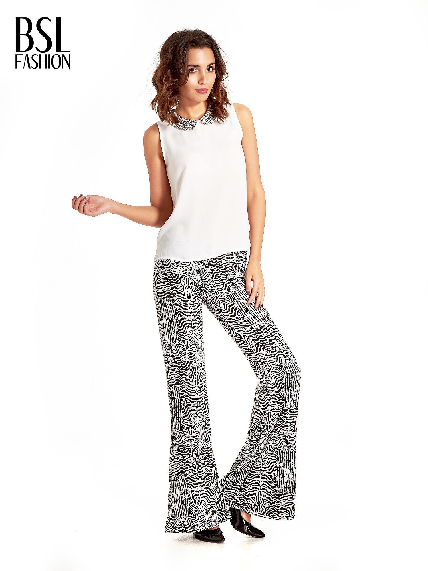 Czarno-białe wzorzyste spodnie typu dzwony                                  zdj.                                  7