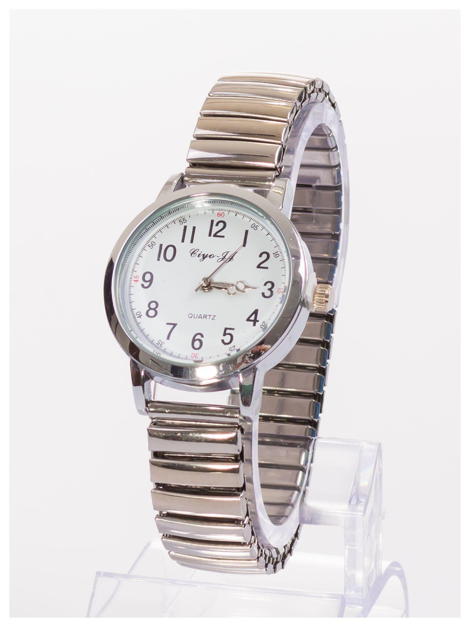 e0fd9e0f6cc64b 1 · Delikatny damski zegarek na srebrnej elastycznej bransolecie ...