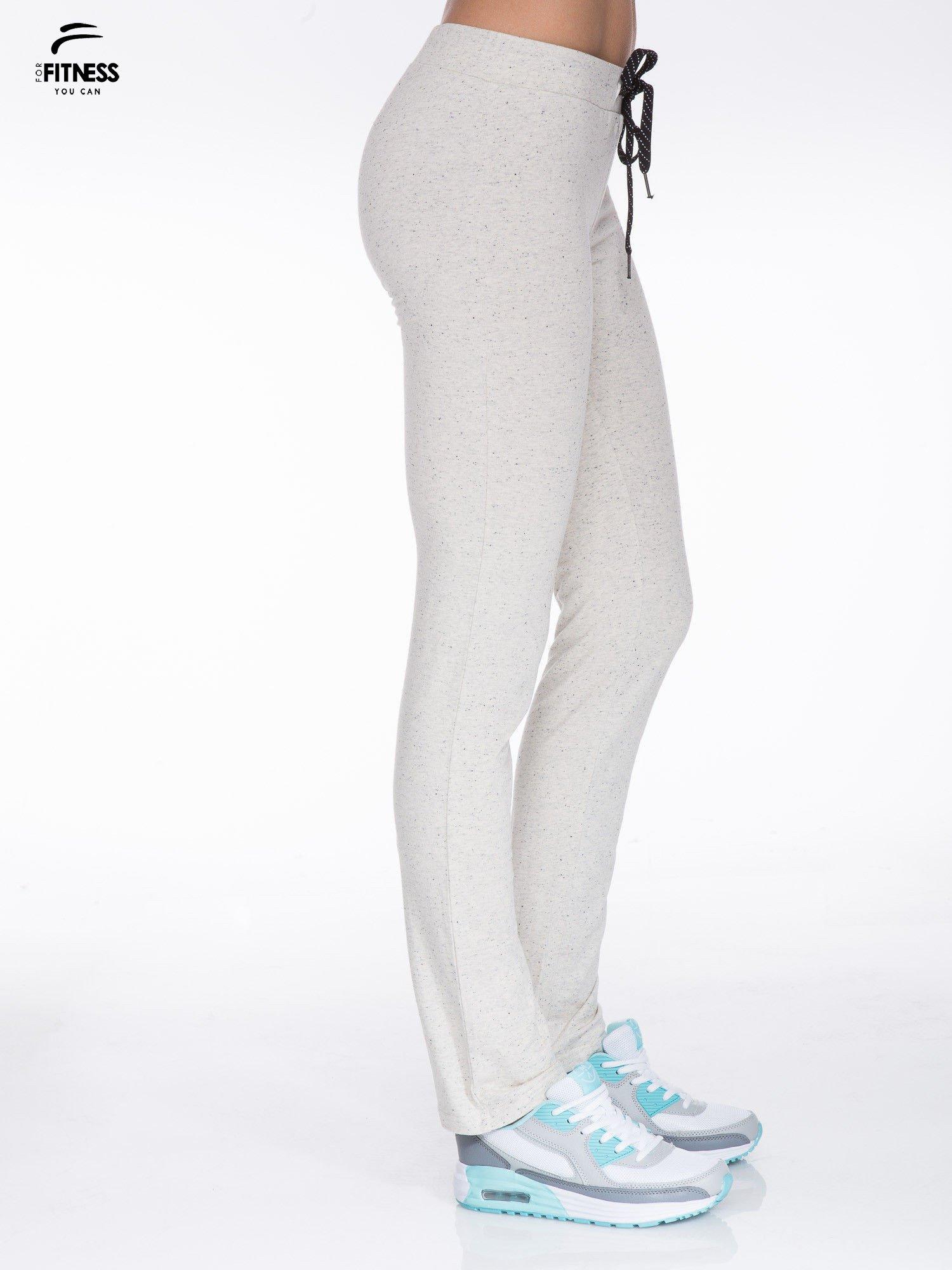 Ecru spodnie dresowe wiązane w pasie                                  zdj.                                  2