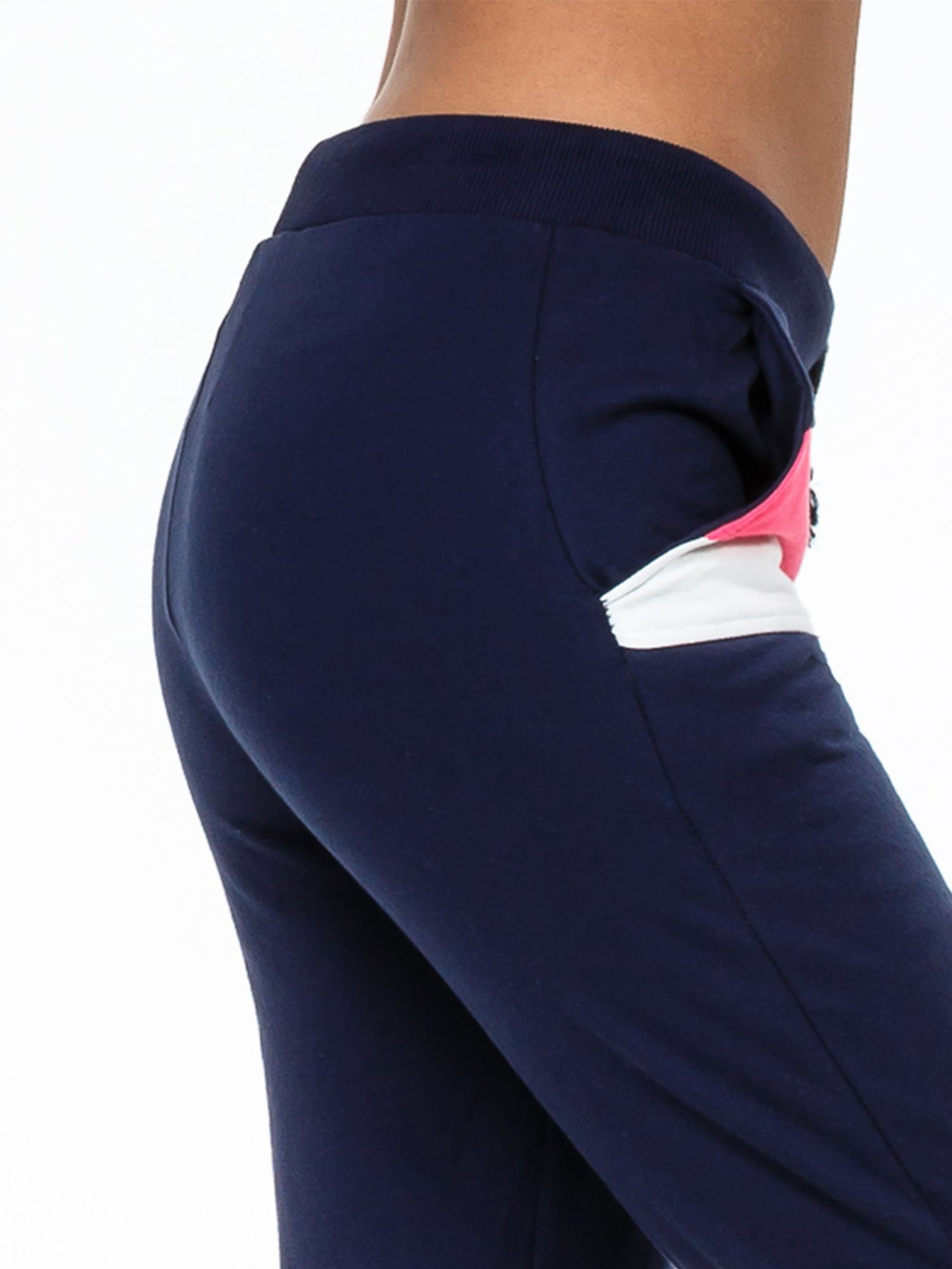 Granatowe spodnie dresowe z kolorową wstawką                                  zdj.                                  5