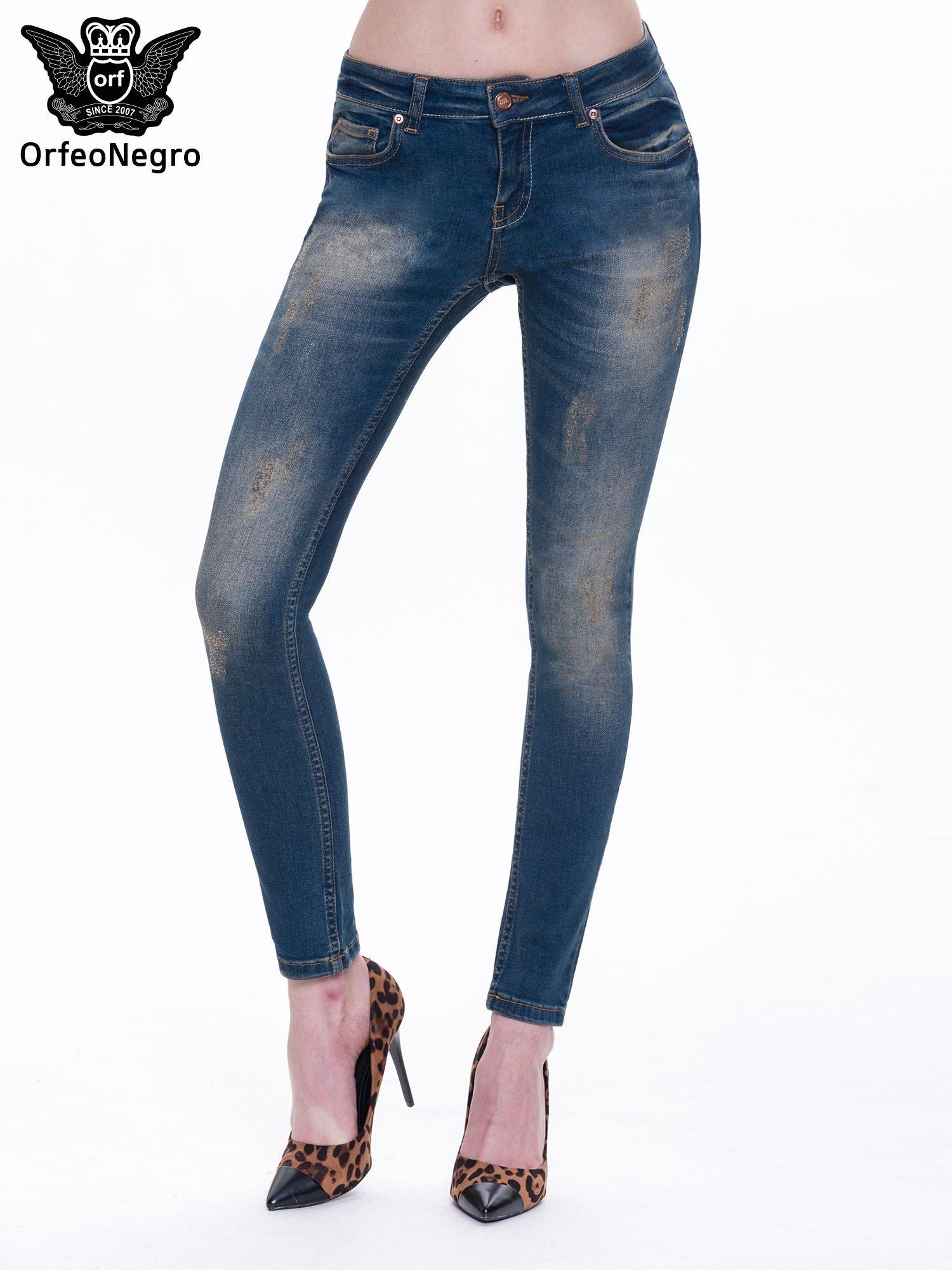 Granatowe spodnie skinny jeans z cieniowaniem i przetarciami                                  zdj.                                  1